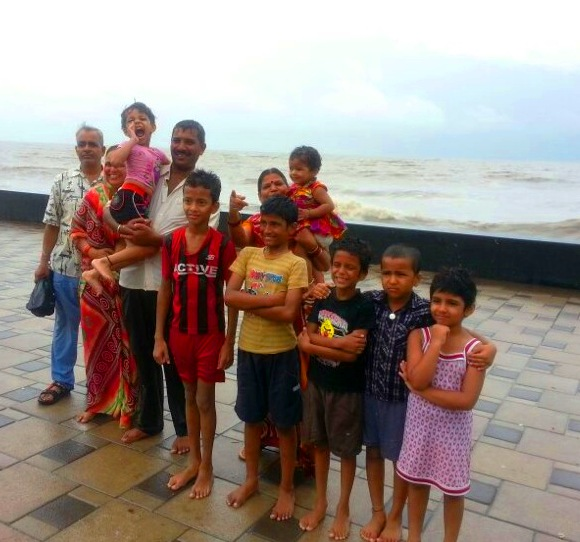 Family Enjoying Bombay Rains